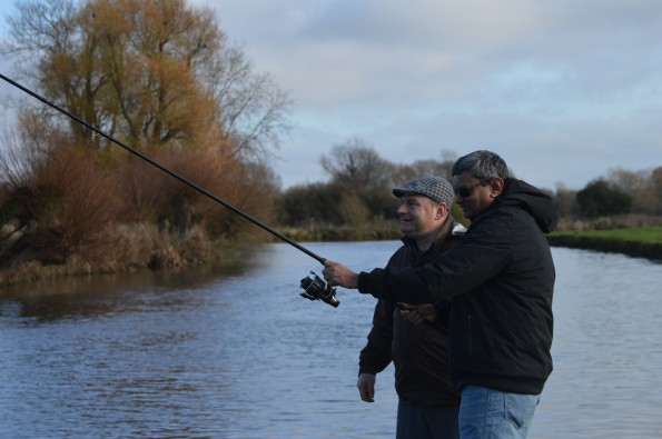 Husband trying his skill in fishing on Thames Lechlade
